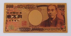 金の一万円札の効果